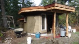 The eco-hut with curved plastered soffits.