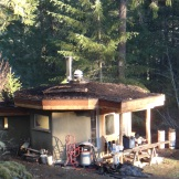 Our 3013 project - the eco-hut. Off-grid, octagonal self supporting roof, living roof, grey water, blown cellulose with earth and lime plasters, kitchen, wood stove, thermosiphon/solar hot water heating. A true tiny house.