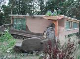 Eco-Sense greenhouse and outside patio with cob oven.