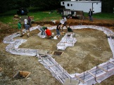 Foundation for Freya's House at OUR Eco Village- Teaching a class on curvilinear foundations using fabric form