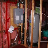 This is the LP gas fired hydro switch on demand hot water system, with the chlorination holding tank in the rear.