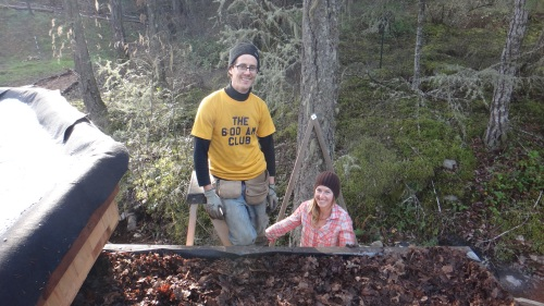Tayler and Solara from Hatchet & Seed helping to install living roof layers on the new Eco-Hut.