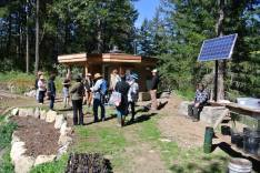 Tour group in front of Eco-Hut (office for farm business)
