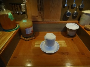 Ginger beer brewing, home made cheese aging on counter, oats and brown rice fermenting on counter.