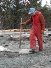 Bob tamping concrete at the Eco-Sense house