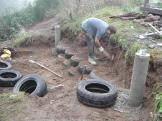 Foundation is rammed earth tires